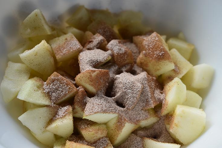 Cinnamon & Sugar On Apples In Bowl